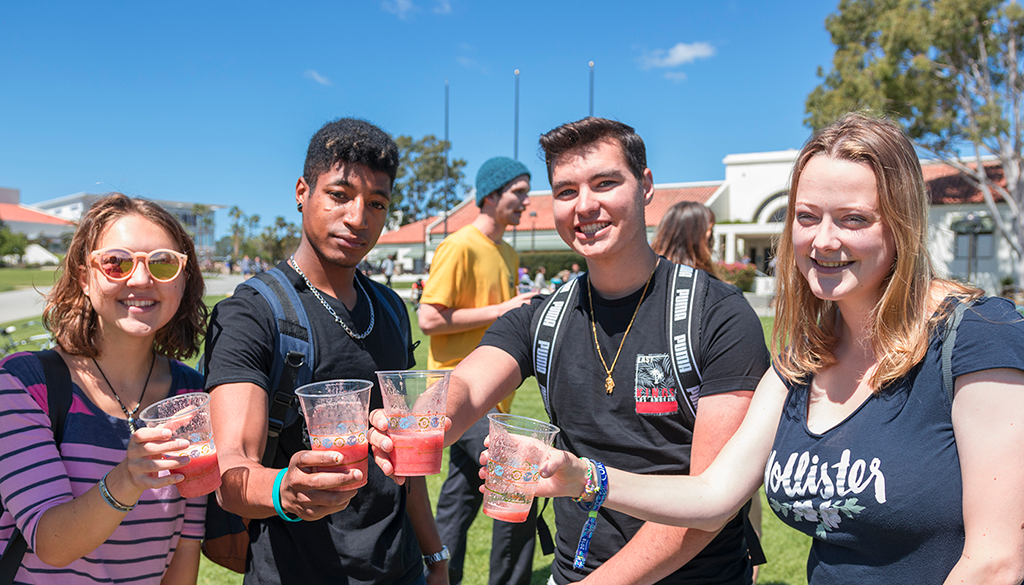 Santa Barbara City College students drinking smoothies at Earth Day